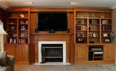 I like the use of moulding and the large with shelving at the top shelf. I would have prefered that the crown moulding be flush with the ceiling but existing moulding in white pre-existed. built in cabinets around fireplace   Built In Cabinets Ideas, Designs, Portfolio,Gallery, New York, NY