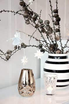 Branches with pine cones on them slipped into a container. Simple yet lovely natural decor.