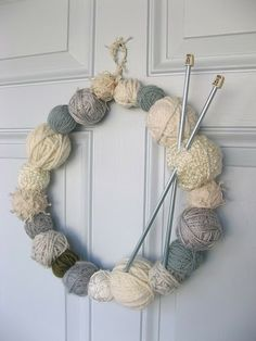 Yarn wreath.  Perfect way to stash bust!  via nook.