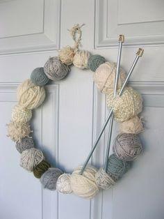 Yarn wreath.  Perfect way to stash bust!  via nook.