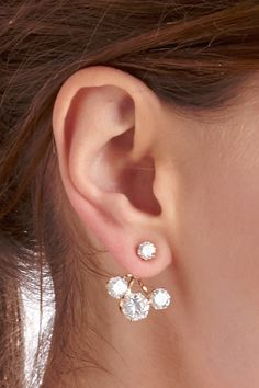 Front to back earrings with a trio of sparkling crystal stones