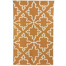 love the moroccan inspired pattern on rust colored rug