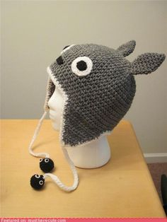 totoro hat with flaps and soot sprites - no pattern, just inspiration: http://www.etsy.com/listing/76420417/reserved-for-gellem-totoro-earflap-hat