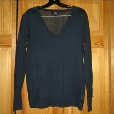 A.N.A Blue Long Sleeve V Neck Top This dark blue v neck long sleeve shirt looks like a sweater but is more like a thicker shirt fabric. Overall still in good condition but there is a small hole toward the bottom left side seam (please see pic). Has accent buttons around the wrist area. Made of 60% cotton 40% polyester. Tag size is Medium. a.n.a Tops Tees - Long Sleeve