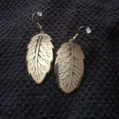 Custom made silver leaf earrings Beautiful custom made silver earrings. The E on the back is the designers initial.  (He is a Navajo Native American jewelry designer) Jewelry Earrings