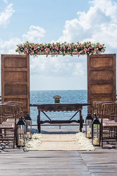 Try this unique idea of standing beneath a wooden doorway for your ceremony at Now Sapphire Riviera Cancun!