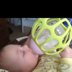 Cage for a bottle to help baby learn to hold the bottle. It works great for my 11 week old daughter who was already trying hold the bottle before we got it theoriginalbaby.c...