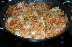 Creole Jambalaya with shrimp, ham, tomato, and Andouille sausage