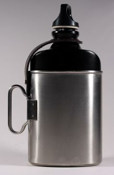 SIGG 'Classic' canteen+cup set - based on the design of the 1930's-1970's issue Swiss army original items, also made by SIGG. Features a Stainless steel welded cup rather than the original one piece aluminium and a leather retaining strap. http://cgi.ebay.co.uk/ws/eBayISAPI.dll?ViewItem&item=111292560175