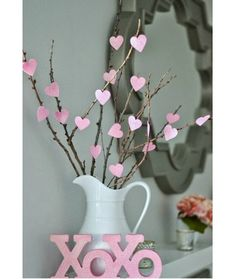 Valentine's Day Branches - This simple project proves that decorating for Valentine's Day can be done on a tiny budget. For less than the cost of a cup of coffee, you can create this festive arrangement made with branches from your own backyard.  To make: Money Hip Mamas