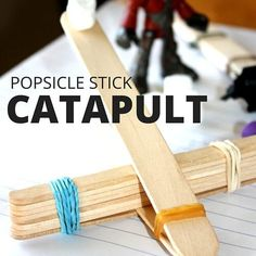Make a simple popsicle stick catapult for fun play at home. A popsicle stick catapult is a great STEM activity and boredom buster on bad weather days!