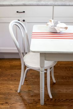 "To create a permanent ""table runner,"" on your dining room table tape off four evenly spaced lines down a table's center and apply paint."