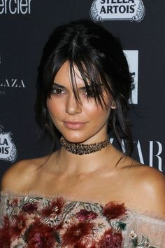 She kept the cuts (and faux cuts) coming, sporting a set of shaggy bangs and a loose updo later that year. #refinery29 http://www.refinery29.com/2016/11/128380/kendall-jenner-birthday-best-makeup-hair#slide-18