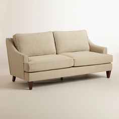 Straw Ellis Sofa | World Market $749.99 Two of these facing a farmhouse table