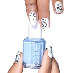 petal please by essie - this nail art design adds a delicate flourish to a basic blanc mani.