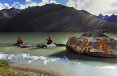 """Om Mani Padme Houng by Matthieu Ricard Two Tibetan monks at the banks of Lake Yilung Lhatso in eastern Tibet. The icy lake of Yilung Lhatso, was given its name, which means """"Divine Lake of the Mind's Delight"""", in memory of a Tibetan princess who passed by this lake on her way to marry one of the ministers of the legendary King Gesar.  The engraving on the rock reads """"Om Mani Padme Hum"""": the mantra of the Buddha of Compassion, Avalokiteshvara"""