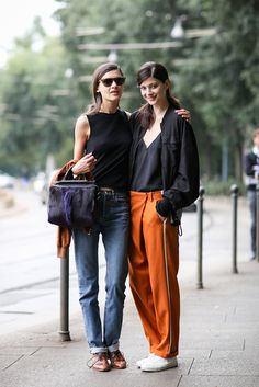 How To Dress Like An Italian Girl — 50+ Lessons Worth Knowing #refinery29  http://www.refinery29.com/2014/09/74945/milan-fashion-week-2014-street-style#slide36  Relaxed fit never looked so chill.