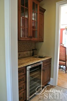 Kitchen Cabinetry by Designs by SKill, LLC with CWP Cabintery, Whitfield Door, Natural Cherry with Brown Petina Glaze, Millstone Paint with Brown Patina Glaze