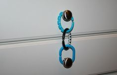 Use chain clips as a child proof for cabinet drawers in kitchen