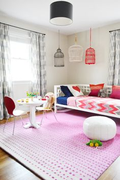 Pattern and colour-filled playroom. Love the bird cages #kids #play #spaces