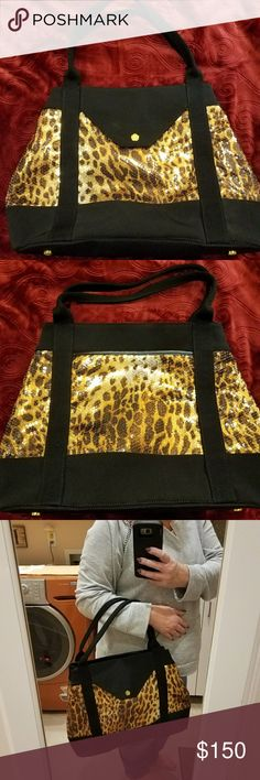 "Eric Javits ~ ""Wild Thing"" Convertible Large Tote Eric Javits,  NWOT.  Lightweight & durable. Made from black Italian canvas & carefully attached/stitched sequins in an animal pattern.  4 snaps on either side help adjust the overall size of this bags silhouette.  2 approx 8 X 8 exterior pockets with zipper & snaps closures.  Interior pockets include a 10 X 8, large enough to hold an IPad. 4 add'l interior pockets plus a key leash & metal feet for protection.  Stunning & practical with…"