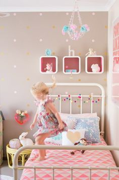 A taupey brown is enlivened with pink accessories and textiles in this girl's bedroom.