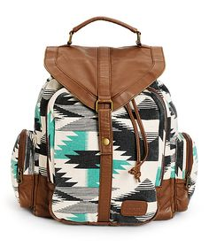 Made with a durable tribal print canvas and contrasting faux leather trim, this rucksack backpack offers ample storage space along with padded shoulder st