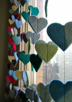 felt.  Could do this with stars, flowers?  So cute.  Would be great for a playroom window... or any window people don't need to look out  (over kids' bathroom window?  Or far right window in sunroom?)