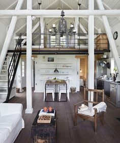 all white interior with white beams and loft