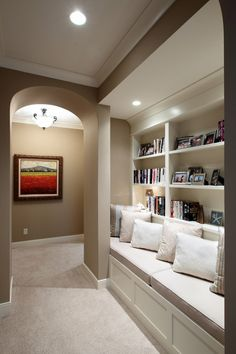 Hallway Library - good use of wall space! And love the wall color