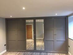 A gorgeous fitted wardrobe with sliding doors and mirrored panels finished in Moles Breath grey. Made and installed in the south West. Fitted Wardrobe Doors, Mirrored Wardrobe Doors, Bedroom Built In Wardrobe, Fitted Bedroom Furniture, Fitted Bedrooms, Sliding Wardrobe Doors, Diy Wardrobe, Bedroom Loft, Closet Doors