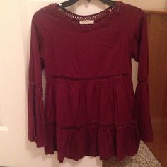 Boutique top!! Re-posh because it's too small! Love the shirt!! Burgundy color with see through stitching! Still has the plastic from the tag! It was never worn! Tops Blouses