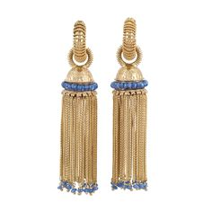 Gold and Sapphire Bead Fringe Earrings    The gold hoops surmounted by rope-twist wire, joined by a circle link of similar motif attached to a bell-shaped engraved cap encircled by sapphire beads, supporting a multistrand herringbone chain fringe alternately tipped by 32 sapphire beads.