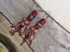 Sea Monkies  earrings with venetian glass and wired by PyxeeStyx, $45.00