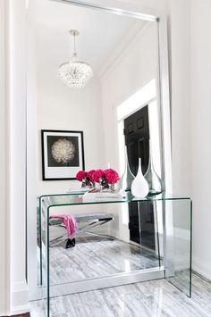My wife's office (entry way).  The pink flowers are a great way to add color in this mirrored entry way.