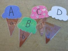 This busy bag upper-lower-case-letter-cone idea would be a bit more expensive for the laminating, but I love it!