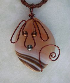 Unique Brown Wire Dog on Stripped Agate Pendant Necklace. $12.50, via Etsy.