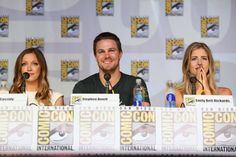 ARROW series star Stephen Amell (Oliver Queen), flanked by the two women in Oliver's life (L-R) Katie Cassidy (Laurel Lance) and Emily Bett Rickards (Felicity Smoak) at the Comic-Con panel session