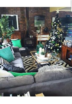 Instagram: @brandilovedesigninterior  Lappljung Ruta Rug from Ikea. Christmas Decor.  Green & Grey Living Room