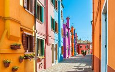 The Venetian island of Burano from the sea (with jewel colored homes). www.yahoo.com