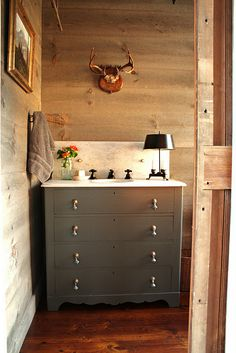 Love this dresser turned into a sink. Marble top with that dark gray paint color. So cool.