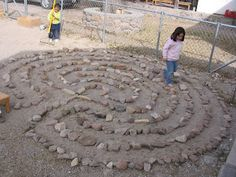 Add a Labyrinth to your yard-a good thing in so many ways-I think DH will have to haul home lots more field stones.