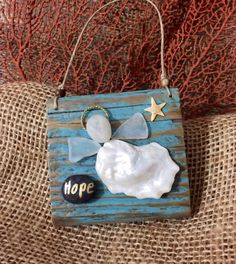 Oyster shell hope angel inches on driftwood. Coastal Christmas Decor, Christmas Crafts, Christmas Decorations, Christmas Ornaments, Ocean Crafts, Beach Crafts, Diy And Crafts, Seashell Projects, Seashell Crafts