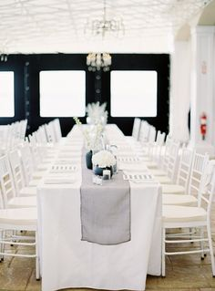 """This all white, with a hint of grey and black, reception set up is just screaming """"modern bride""""!    Photo:  Pen Carlson"""