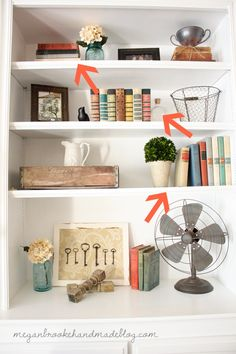 How to decorate bookshelves: flowers, plants, photo frames, books of same size, vases