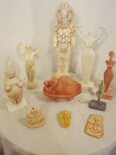 Ancient Goddess statues - starting with tallest and moving clockwise- Artemis of Ephesus, Nile River Goddess, Cucuteni Bird Goddess, Late Cucuteni Bird Goddess, Doorway Goddess, Nile River Goddess (pocket version), Venus of Malta, Venus of Willendorf , Bird-Headed Snake Goddess and Dreamer of Malta (in the centre of the circle)