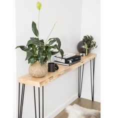 Made from solid Macrocarpa , hand made in Tasmania with a choice of either white or black powder coated hairpin legs. The hall stand features a stunning natural edge making each hall stand unique.