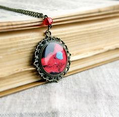 Black redblue pendandt with a print of cells by OPStyle on Etsy, $18.00