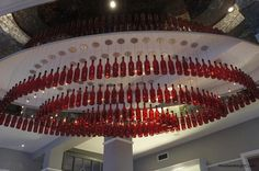14 red wine bottle chandelier http://hative.com/creative-wine-bottle-chandelier-ideas/