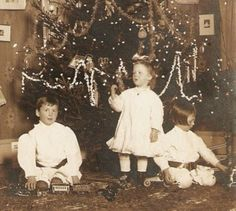 Victorian children playing with their new toys on Christmas...